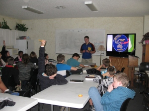Josiah sharing at a Christian School