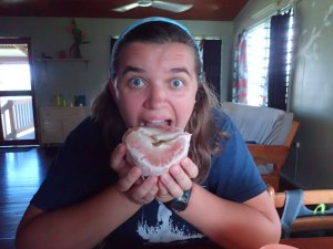 Rachel eating a pomelo (her favorite fruit in PNG!)
